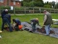 Removing first layer for Test Pit 1 and metal detecting the soil removed.